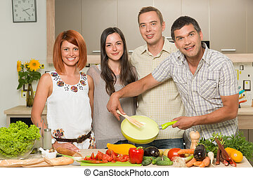 happy friends cooking dinner