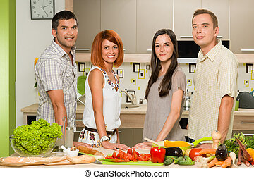 friends posing while cooking
