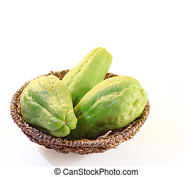 Chayote squash, also known as choko in wooden basket on...