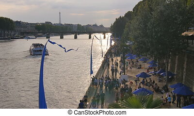 people walking seine esplanade - Paris july 01:seine...