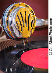gromophone speaker on vinyl disk close up