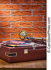 vintage gramophone on table and background of brickwall