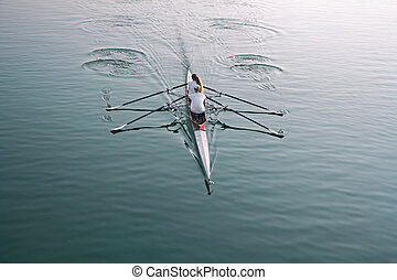 Rowing on the lake - Man and woman in a boat, rowing on the...