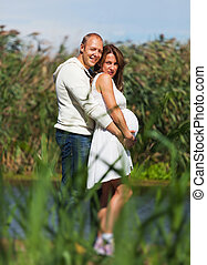 Husband holding pregnant wife