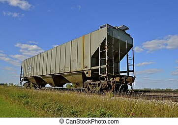 Lone boxcar on the track - A solitary boxcar is left on the...
