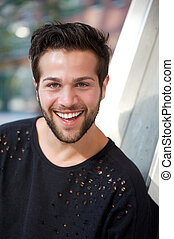Smiling young man with beard - Close up portrait of a...