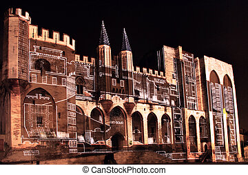 Popes Palace in Avignon, France by night - The walls of the...