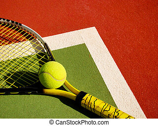 detail of a tennis court with ball and racket...