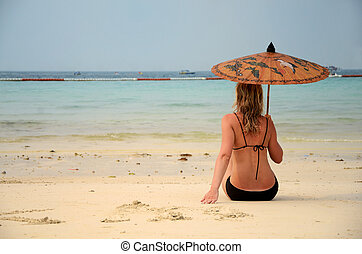 woman resting on the beach