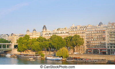 parisian building on the seine - paris traditional building...