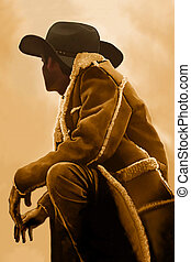 OUT WEST - A cowboy takes time to rest and reflect