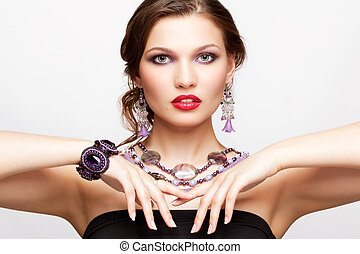 Beautiful young woman in necklace - Portrait of beautiful...