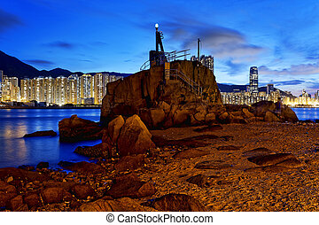 Hong Kong Lei Yue Mun sunset - lighthouse at sunset,Hong...