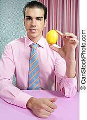 Funny businessman with lemon fruit on hand