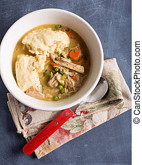 Chicken and Dumplings - A bowl full of homemade chicken and...