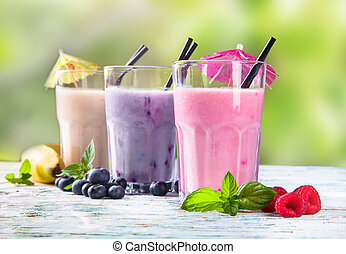 Fresh fruits milk shake on wood - Fresh milk, strawberry,...