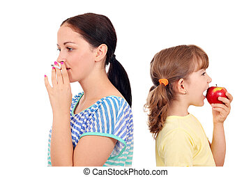 girl smoking a cigarette and little girl eating an apple