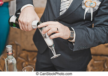 The man pours wine in a glass.