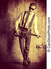 musician vintage - Expressive young man playing rock-n-roll...