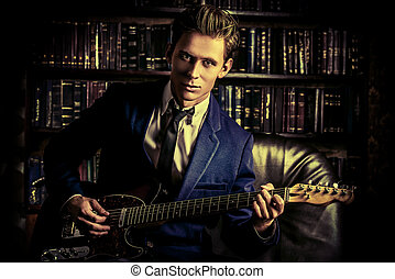 songwriter - Handsome young man playing rock-n-roll music on...