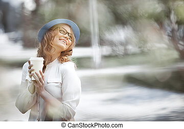 Coffee and happiness. - Happy young fashionable woman taking...