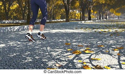 Woman jogging in the autumn park - Young woman jogging in...