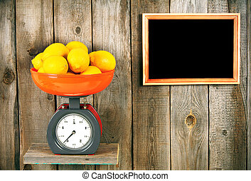 Lemons on scales on a wooden shelf A framework on a wooden...