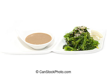 seaweed salad and wasabi sauce on a white background
