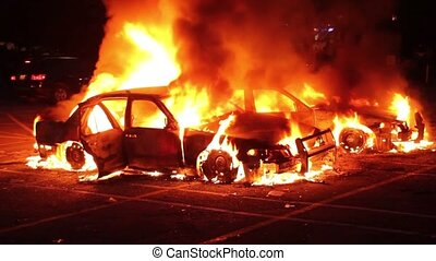 Car fire during riot with SWAT - Two burning cars at night...