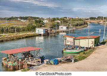 fishing huts in Comacchio, Ferrara, Italy - landscape of the...
