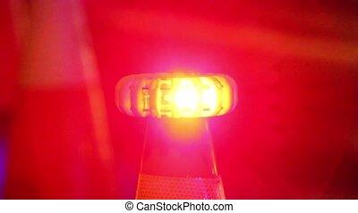 Orange traffic cones flashing - Orange traffic cones lit and...