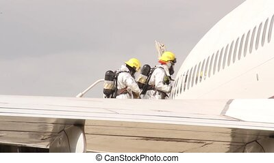 Airport fire crews entering plane - Special airport unit...