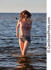seminude woman against sea background - Attractive young...