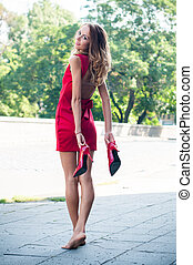 woman without her shoes - Beautiful young slim woman on an...