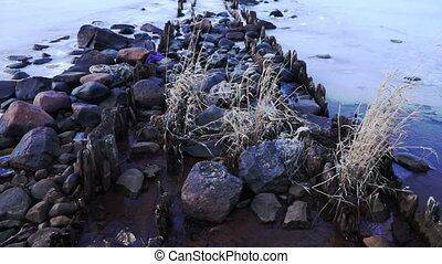 Pier at Onega lake in winter, close up - Rocky pier at...