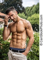 Handsome shirtless young man outdoor - Handsome shirtless...