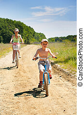 Mother and son with bicycles