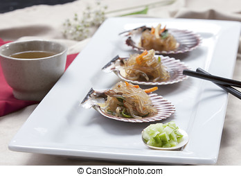 Korean noodles on a shell. - A Korean delicacy called Chop...