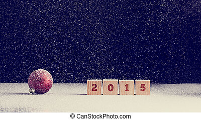 2015 New Year background with snow falling onto a red...