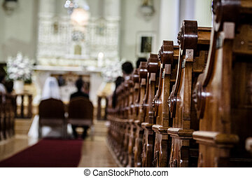 Wedding Ceremony inside a Church with Blurry Couple in...