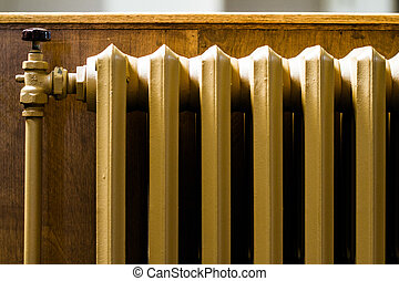 Beige Water Radiator Heater on a Wall