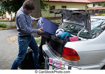 Car trunk full of luggage - Horizontal view of car trunk...