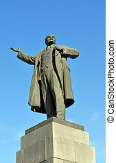 Lenin sculpture over blue sky