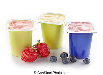 various plastic yogurt pots on a white background