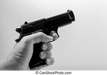Hand holding firearm, Black and white image