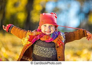 Happy little girl playing in the autumn park - Happy little...