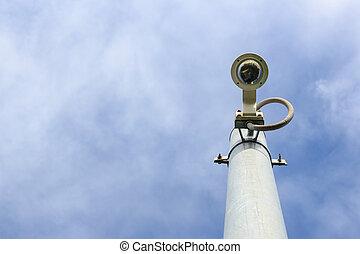 cctv camera on sky background - cctv camera on sky with...