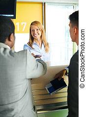 Registration of passengers - Smiling female returning...