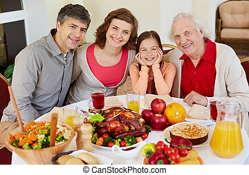 Thanksgiving festivity - Portrait of happy family sitting at...