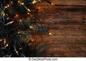 Christmas. Fir with garland on the table - Christmas, New...